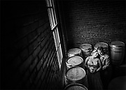 A bride and groom at the New Liberty Distillery and the 23rd Street Armory in Philadelphia, Pennsylvania.