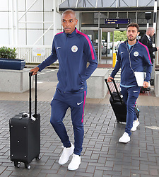 Fernandinho and Bernardo Silva as the Manchester City team arrive at Manchester Airport as they jet for Iceland