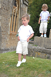 ELWEN CAMERON son of David Cameron at the wedding of Lohralee Stutz and the Hon.William Astor at St.Augustine's Church, East Hendred, Oxfordshire on 5th September 2009.