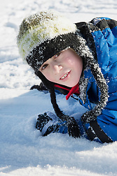 Portrait of boy in snow, smiling, Bavaria, Germany