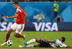 June 19, 2018 - Saint Petersburg, Russia - Roman Zobnin (L) of the Russia national football team vie for the ball during the 2018 FIFA World Cup match, first stage - Group A between Russia and Egypt at Saint Petersburg Stadium on June 19, 2018 in St. Petersburg, Russia. (Credit Image: © Igor Russak/NurPhoto via ZUMA Press)