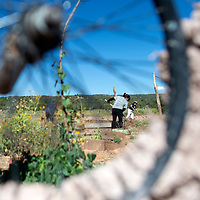 092014      Cayla Nimmo<br /> <br /> A recycled bike tire is used at the entrance of the wall surrounding the Lupton Community garden while several volunteers work on the inside of the garden Saturday morning.