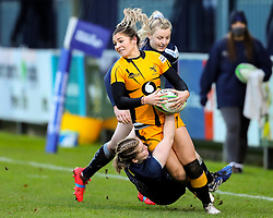 Amy Wilson Hardy of Wasps Ladies is tackled by Daisy Hibbert-Jones of Sale Sharks Women  - Mandatory by-line: Nick Browning/JMP - 12/12/2020 - RUGBY - CorpAcq Stadium  - Sale, England - Sale Sharks Women v Wasps FC Ladies - Allianz Premier 15s