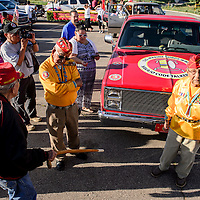 081415       Cable Hoover<br /> <br /> Navajo Codetalkers David Patterson, right, William Toledo and Fleming Begaye greet each other at the start of the Codetalker Day parade Friday in Window Rock.