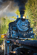 The Durango and Silverton Narrow Gauge Railroad (D&SNG) is a narrow gauge heritage railroad that operates 45 miles of 3 ft track between Durango and Silverton, in the US state of Colorado. The railway is a federally designated National Historic Landmark and is also designated by the American Society of Civil Engineers as a Historic Civil Engineering Landmark.<br /> The route was originally built between 1881 and 1882, by the Denver and Rio Grande Railway, in order to carry supplies and people to and silver and gold ore from mines in the San Juan Mountains. The line was an extension of the D&RG narrow gauge from Antonito, Colorado to Durango. The last train to operate into Durango from the east was on December 6, 1968. The States of New Mexico and Colorado purchased 64 miles of the line between Antonito and Chama, New Mexico in 1970 and operates today as the Cumbres and Toltec Scenic Railroad. The trackage between Chama and Durango was abandoned and rails were removed by 1971.