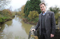 © Licensed to London News Pictures. 02/12/2014 <br /> Nick Clegg with The River Medway in Yalding,Kent.<br /> The deputy prime minister Nick Clegg has been in Yalding in Kent today (02.12.2014) to annouce funding for flood defences in the village. This comes a year after the Kent town was severly flooded last Christmas.<br /> (Byline:Grant Falvey/LNP)