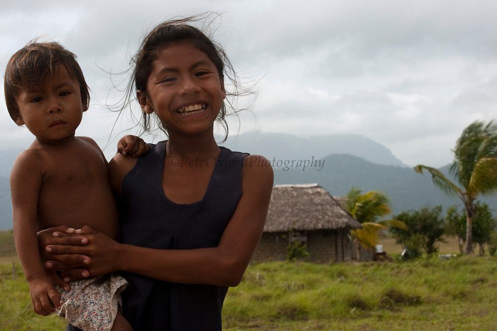 Amerindian<br /> Nappi Amerinidian Village with Kanuku Mountains<br /> Rupununi<br /> GUYANA<br /> South America