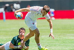 July 22, 2018 - San Francisco, CA, U.S. - SAN FRANCISCO, CA - JULY 22: England's William Edwards is grabbed from behind during the semifinal match between England and South Africa at the Rugby World Cup Sevens on July 22, 2018 at AT&T Park in San Francisco, CA. (Photo by Bob Kupbens/Icon Sportswire) (Credit Image: © Bob Kupbens/Icon SMI via ZUMA Press)