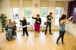 Pictured: Nicola Sturegoan joined in a Health and Wellbeing tai chi class<br /> <br /> The First Minister Nicola Sturgeon, MSP, joined people supported by the Thistle Foundation to bury a time capsule to mark the opening of a new health and social care centre. <br /> Ger Harley | EEm 14 June 2016