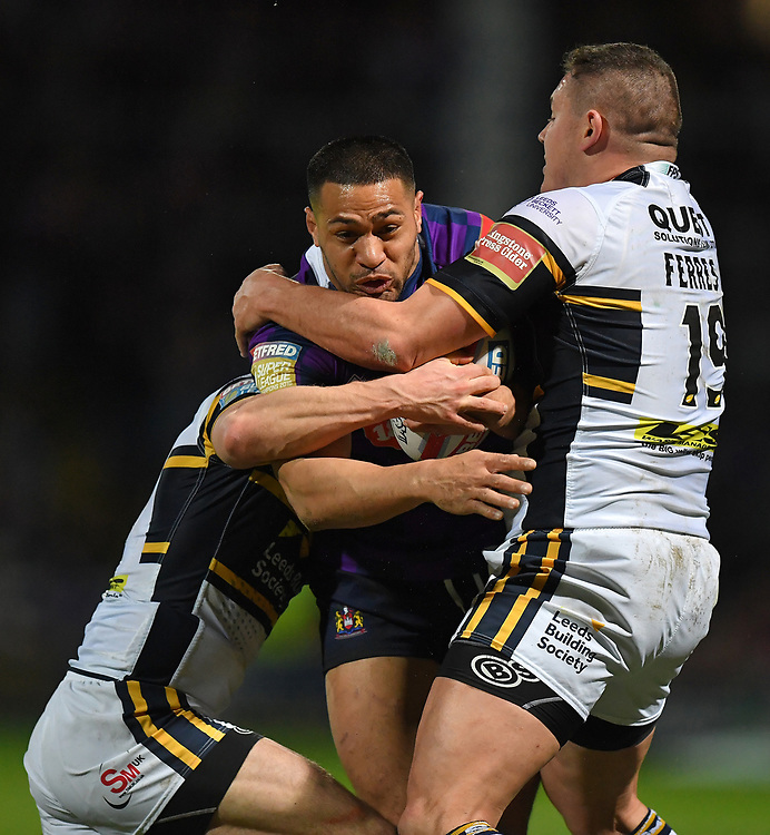 Wigan Warriors' Willie Isa is tackled by Leeds Rhinos's Brett Ferres<br /> <br /> Photographer Dave Howarth/CameraSport<br /> <br /> Betfred Super League Round 7 - Leeds Rhinos v Wigan Warriors - Headingley Stadium - Leeds<br /> <br /> World Copyright © 2017 CameraSport. All rights reserved. 43 Linden Ave. Countesthorpe. Leicester. England. LE8 5PG - Tel: +44 (0) 116 277 4147 - admin@camerasport.com - www.camerasport.com