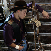 Gustavo Trevino, 17, spends a moment alone before riding his second bull of the day during a Texas High School Rodeo Association event in Kingsville. Trevino did not cover, or complete the eight-second ride, on either of his bulls, but earned enough points in other rodeos to qualify to travel to the state finals in Abilene this June. <br /> Nathan Lambrecht/The Monitor