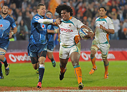 PRETORIA, South Africa, 28 May 2011. Bjorn Basson of the Bulls is handed-off by Ashley Johnson of the Cheetahs during the Super15 Rugby match between the Bulls and the Cheetahs at Loftus Versfeld in Pretoria, South Africa on 28 May 2011..Photographer : Anton de Villiers / SPORTZPICS
