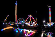 WASHINGTON, USA - August 19: The amusement rides of the Montgomery County Agricultural Fair shine with multicolored lights in the night sky in Gaithersburg, Md., USA on August 19, 2017.