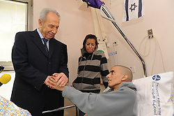SHIMON PERES (2 August 1923 - 28 September 2016) was a Polish-born Israeli statesman. Born Szymon Perski, he was the ninth President of Israel from 2007 to 2014, served twice as the Prime Minister of Israel and twice as Interim Prime Minister, and he was a member of 12 cabinets in a political career spanning over 66 years. Peres won the 1994 Nobel Peace Prize together with Yitzhak Rabin and Yasser Arafat for the peace talks that he participated in as Israeli Foreign Minister, producing the Oslo Accords. PICTURED: Jan 19, 2009 - Petach-Tikva, Israel - Israel president SHIMON PERES visiting wounded soldiers at the Rabin Medical Center-Belinson. (Credit Image: © Israel Hadari/ZUMA Press)