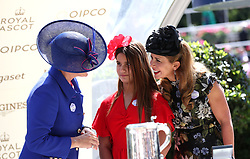 Princess Haya of Jordan (right) and daughter Sheikha Al Jalila bint Mohammad bin Rashid al Maktoum are presented with a trophy by Clare Balding after winning the King Edward VII Stakes with Old Persian during day four of Royal Ascot at Ascot Racecourse.