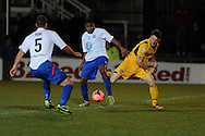 Conor Washington of Newport ® is tackled by Ryan Peters of Braintree (c) .FA cup with Budweiser, 1st round replay, Newport county v Braintree Town at Rodney Parade in Newport, South Wales on Tuesday 19th November 2013. pic by Andrew Orchard, Andrew Orchard sports photography,