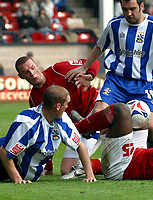 Photo: Dave Linney.<br />Walsall v Huddersfield Town. Coca Cola League 1. 22/04/2006A .Goalmouth Scramble at Walsall v Huddersfield. With Walsall's James Constable in the thick of it.