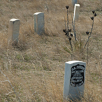 Monuments mark where General George Custer and some of his men fell at the Little Bighorn Battlefield National Monument, Montana