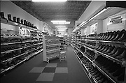 24/05/1966<br /> 05/24/1966<br /> 24 May 1966<br /> Farren's shoe Store, Parnell Street, Dublin. Interior view of the store showing the shelves of shoes, particularly the Squadron brand of mens shoe.