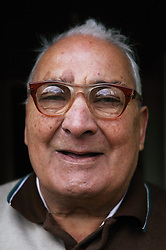 Portrait of elderly Asian man smiling, ***NOT TO BE USED IN THE EAST MIDLANDS***