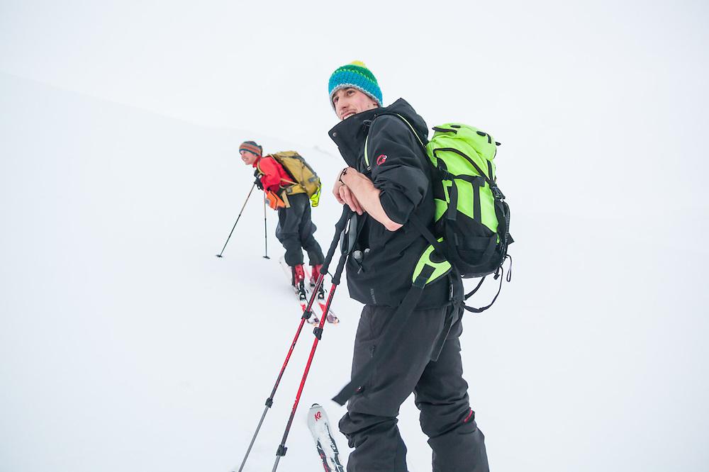Stefan Schöttl (front) and Mylène Jacquemart relax on a ski tour on Trollsteinen, Svalbard.