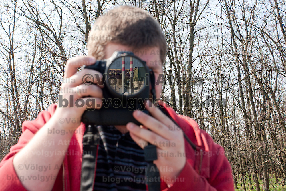 Photographer takes photo of the Paks nuclear power plant reflected on the lens in Paks, 120 km (75 miles) east of Budapest, Hungary on March 23, 2011. ATTILA VOLGYI
