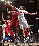 CHARLOTTESVILLE, VA- December 7: China Crosby #1 of the Virginia Cavaliers reaches for the rebound with Devon Brown #40 of the Liberty Lady Flames during the game on December 7, 2011 at the John Paul Jones arena in Charlottesville, Va. Virginia defeated Liberty 64-38. (Photo by Andrew Shurtleff/Getty Images) *** Local Caption *** China Crosby;Devon Brown
