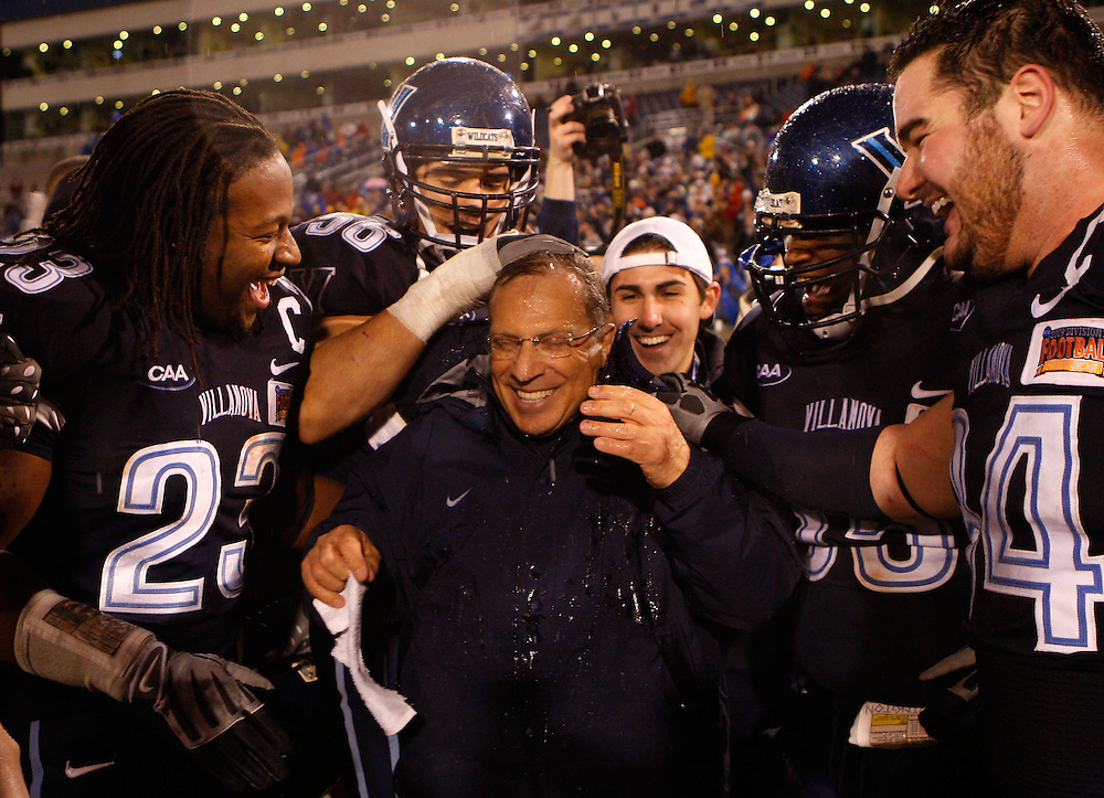 CHATTANOOGA, TN - DECEMBER 18:  Head coach Andy Talley of the Villanova Wildcats is congratulated by some his players after the NCAA FCS Championship game against the Montana Grizzlies at Finley Stadium on December 18, 2009 in Chattanooga, Tennessee.  The Wildcats beat the Grizzlies 23-21.  (Photo by Mike Zarrilli/Getty Images)