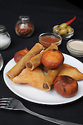 Deep fried savoury pastries filled with meat Originally from Morocco