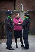 Local police officers talk to a local lady on the first anniversary of the Grenfell tower block disaster, on 14th June 2018, in London, England. 72 people died when the tower block in the borough of Kensington & Chelsea were killed in what has been called the largest fire since WW2. The 24-storey Grenfell Tower block of public housing flats in North Kensington, West London, United Kingdom. It caused 72 deaths, out of the 293 people in the building, including 2 who escaped and died in hospital. Over 70 were injured and left traumatised. A 72-second national silence was held at midday, also observed across the country, including at government buildings, Parliament.