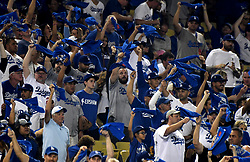 October 6, 2017 - Los Angeles, California, U.S. - Los Angeles Dodgers fans wave towels in the first inning of a National League Divisional Series baseball game against the Arizona Diamondbacks at Dodger Stadium on Friday, Oct. 06, 2017 in Los Angeles. (Photo by Keith Birmingham, Pasadena Star-News/SCNG) (Credit Image: © San Gabriel Valley Tribune via ZUMA Wire)