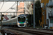 A Seibu 30000 series train on the Seibu Ikebukuro Line  near Shimo Ochiai, Tokyo, Japan January 8th 2015
