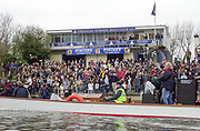 """Putney. London.  2004 University Boat Race,  Championships Course, Putney to Mortlake. <br /> Spectators watch the  Oxford and Cambridge, boat race, from the """"Emanuel Boat House"""", Dukes Meadows, Chiswick..  <br /> <br /> [Mandatory Credit Peter SPURRIER]"""