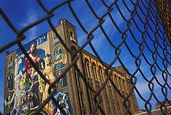 Multi ethnic art mural on school building, Philadelphia, PA.  Lifestyle people family CITY URBAN STOCK PHOTO