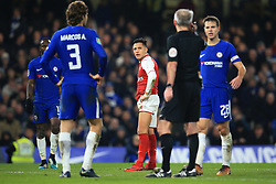 10 January 2018 -  EFL Cup - Semi Final (1st Leg) - Chelsea v Arsenal - Alexis Sanchez of Arsenal looks on as referee Martin Atkinson checks with the VAR - Photo: Marc Atkins/Offside