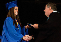 Jennifer Manu is congratulated by Gilford High School Principal Kenneth Wiswell as she receives her diploma during commencement exercises at Meadowbrook Pavilion Saturday morning.  (Karen Bobotas/for the Laconia Daily Sun)Gilford High School Graduation at Meadowbrook Pavilion Saturday, June 11, 2011.Gilford High School graduation June 11, 2011.