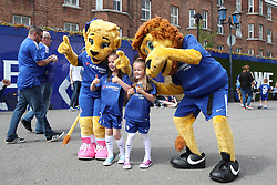 Young Chelsea supporters pose with Chelsea mascots Stamford the Lion and Bridget the Lioness before the Premier League match at Stamford Bridge, London.
