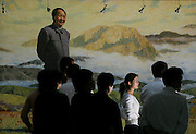 SHAOSHAN, CHINA - 4 NOVEMBER 2005 - Tourists listen to a story about Mao at a museum dedicated to him next, down the road from his ancestral home in Shaoshan. Mao's admirers think that he stood for egalitarianism and righteousness, whereas the current elite looks greedy, corrupt and contemptuous of the lower classes. Photo by Natalie Behring
