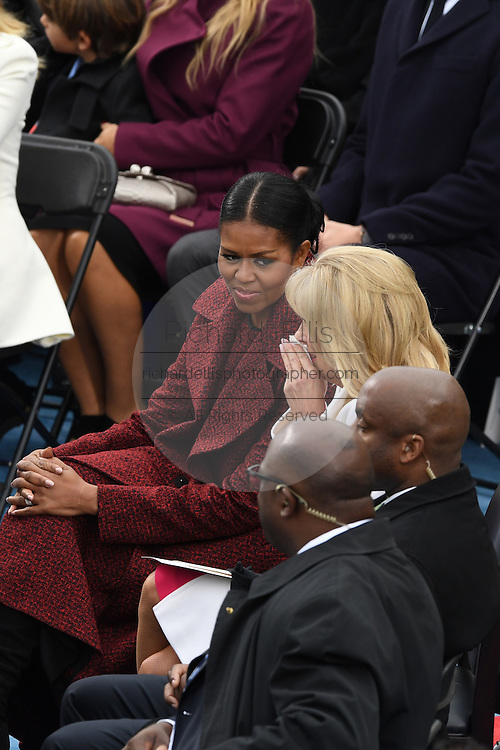 First Lady Michelle Obama looks toward a tearful Dr. Jill Biden during the President Inaugural on Capitol Hill January 20, 2017 in Washington, DC. Donald Trump became the 45th President of the United States.