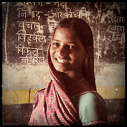 "iPhone portrait of Kavita Ninama, approximate age 14, in a village outside of Banswara, Rajasthan, India, April 5, 2013. ""My father was saying, 'We will get her married.' I refused. I said, 'You get married!' How would I be able to study? I wanted to study more, so I refused to get married… Everything would be ruined if I got married,"" said Ninama.<br /> <br /> Under Indian law, children younger than 18 cannot marry. Yet in a number of India's states, at least half of all girls are married before they turn 18, according to statistics gathered in 2012 by the United Nations Population Fund (UNFPA). However, young girls in the Indian state of Rajasthan—and even a few boys—are getting some help in combatting child marriage. In villages throughout Tonk, Jaipur and Banswara districts, the Center for Unfolding Learning Potential, or CULP, uses its Pehchan Project to reach out to girls, generally between the ages of 9 and 14, who either left school early or never went at all. The education and confidence-building CULP offers have empowered young people to refuse forced marriages in favor of continuing their studies, and the nongovernmental organization has provided them with resources and advocates in their fight."