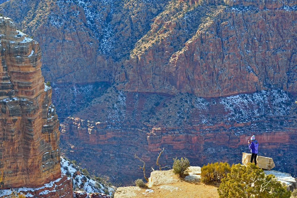 A tourist at the South Rim at Grandview Point, Grand Canyon National Park, Arizona, USA