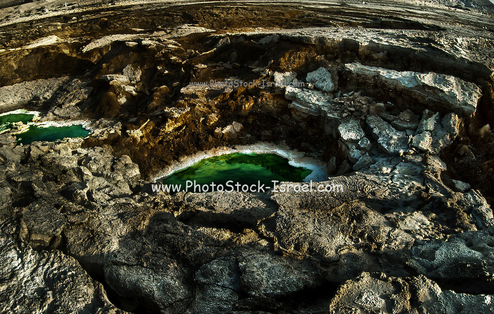 Digitally manipulated image of Water pools in sink holes on the shore of the Dead Sea, Israel