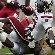 South Carolina Gamecocks cornerback Victor Hampton (27) is tackled by UCF Knights linebacker Michael Easton (15) during an NCAA football game between the South Carolina Gamecocks and the Central Florida Knights at Bright House Networks Stadium on Saturday, September 28, 2013 in Orlando, Florida. (AP Photo/Alex Menendez)