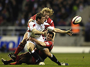 Mark Cueto, passes the ball after being tackled by Gareth Cooper, No 20 and Duncan Jones, as England go on to beat Wales in their opening game of the 2006 RBS Six Nations Match, at Twickenham on the 04.02.2006.   © Peter Spurrier/Intersport Images - email images@intersport-images mob +44[0]7973 819 551..   [Mandatory Credit, Peter Spurier/ Intersport Images].