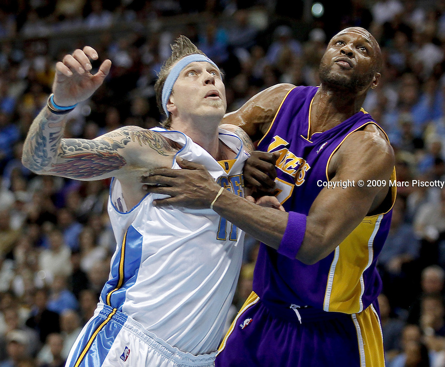 The Denver Nuggets' Chris Andersen (#11) battles the Los Angeles Lakers' Lamar Odom (#7) for position on a rebound during the second half of Game 4 of the NBA Western Conference Finals in Denver May 25, 2009. The Nuggets won the game 120-101 to even the series at 2-2. .(Photo by Marc Piscotty / © 2009)