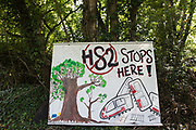 A large sign outside the Stop HS2 Wendover Active Resistance Camp is seen on 17th July 2020 in Wendover, United Kingdom. Environmental activists from groups including Stop HS2 and HS2 Rebellion continue to protest against HS2, which is currently projected to cost £106bn and which will remain a net contributor to CO2 emissions during its projected 120-year lifespan, on environmental and economic grounds.