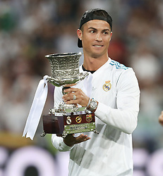 August 17, 2017 - Madrid, Spain - Cristiano Ronaldo of Real Madrid celebrates with the trophy after the Supercopa de Espana Final second leg match between Real Madrid and FC Barcelona at Estadio Santiago Bernabeu on August 16, 2017 in Madrid, Spain. (Credit Image: © Raddad Jebarah/NurPhoto via ZUMA Press)