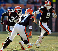 MORNING JOURNAL/DAVID RICHARD.Cleveland rookies Charlie Frye, right, and Braylon Edwards break to the outside to block for running back Reuben Droughns yesterday in the second quarter.