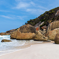 Colossal boulders flank the pristine white sands of Squeaky Beach, Wilsons Promontory National Park, Victoria, Australia.