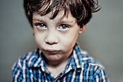 Pop-Up Kids is n on-going series of colour and B/W children portraits.<br /> <br /> One of the things I love about this series is that kids are photographed no matter how they look. Crazy-messy hair? Perfect! Wrinkled t-shirts? Fine by me!<br /> <br /> By connecting with children in five minutes or less, my hope is to bring out a characteristic each child wants to share. What captures my attention is the inherent intelligence and personality children display while having fun in front of my camera.<br /> <br /> Portraits are created using a pop-up studio. No make-up, hair, or wardrobe stylist is used.